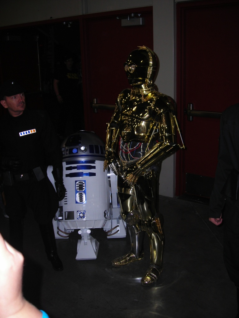 C3P0 and R2D2 and Imperial person